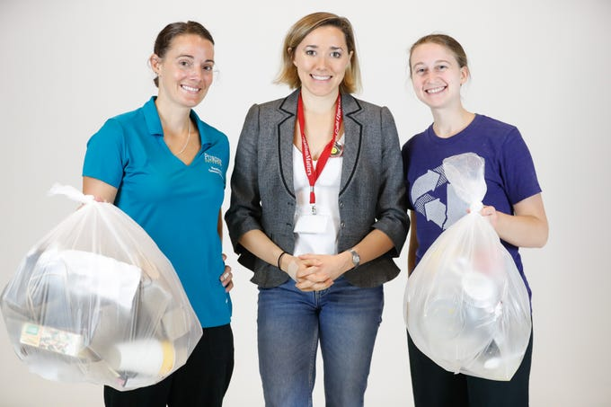 Recycling experts, Kelly Weger, the Lead Service Manager for Sustainability at Purdue University, left, and Julia Spangler, a Sustainable Events Consultant, right go through the Indy Star trash to teach IndyStar Reporter Sarah Bowman, center, how much could be recycled instead of tossed in the landfill on Friday, Sept. 14, 2018. The trash audit found that 75 percent of what IndyStar throws away could be recycled or composted. That percentage is typical for the average household, according to the experts.