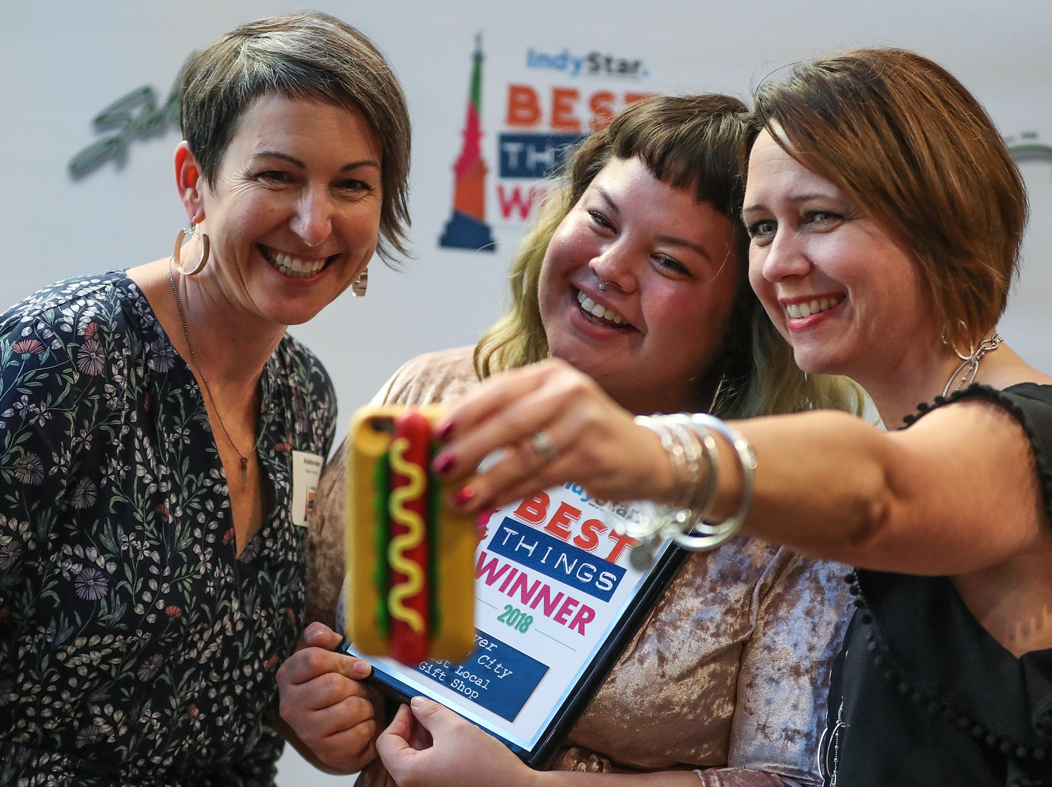 From left, Kristin Kohn, Shea Rodriguez and Julie Johnson from Silver in the City celebrate their win during the inaugural Best Things Indy 2018 award ceremony, held by IndyStar at One America Tower in Indianapolis, Thursday, Sept. 27, 2018.