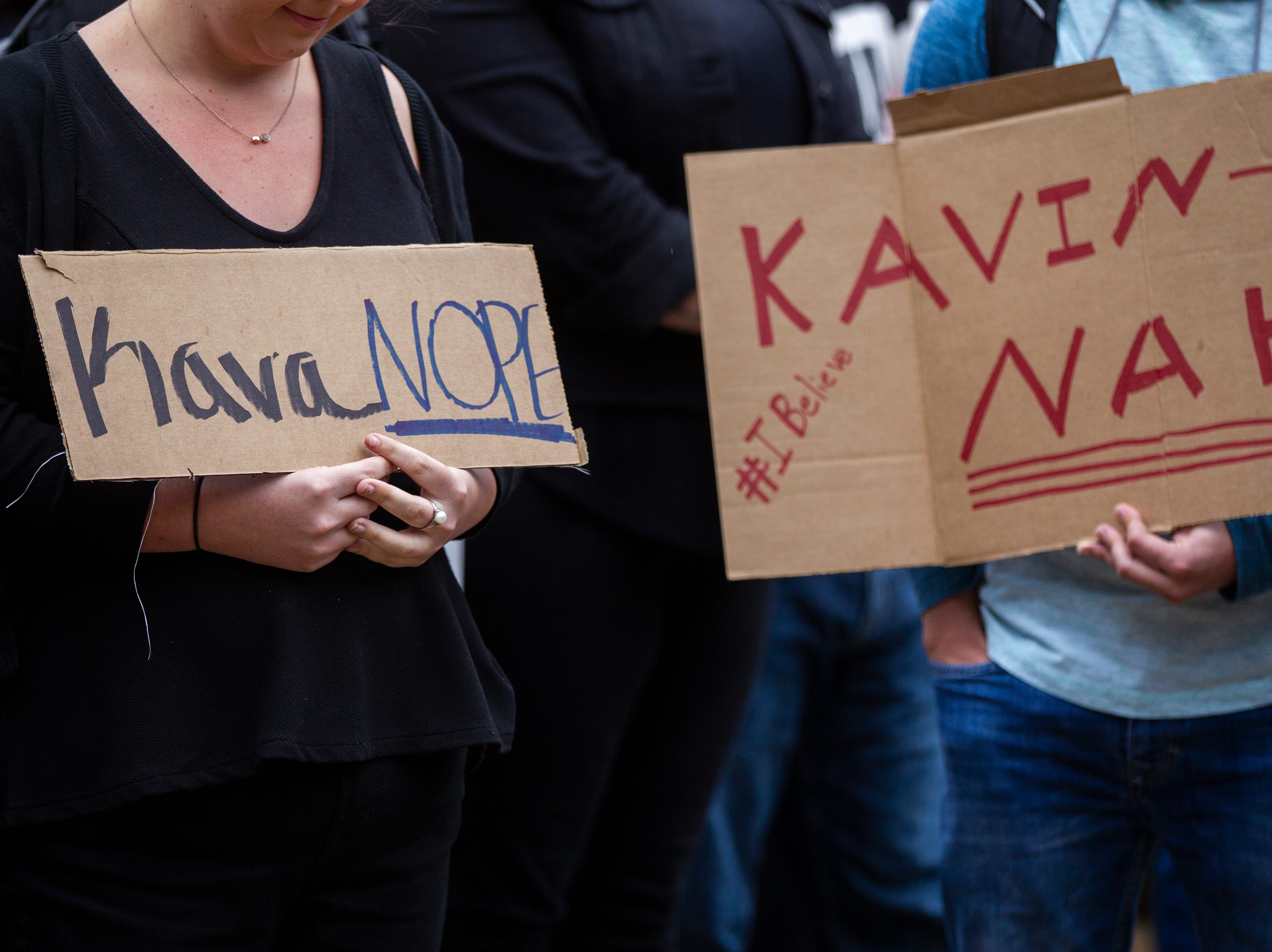 Students hold signs during protest against Supreme Court nominee Brett Kavanaugh on Friday, Sept. 28, 2018, outside the Boyd Law Building on the University of Iowa campus in Iowa City.