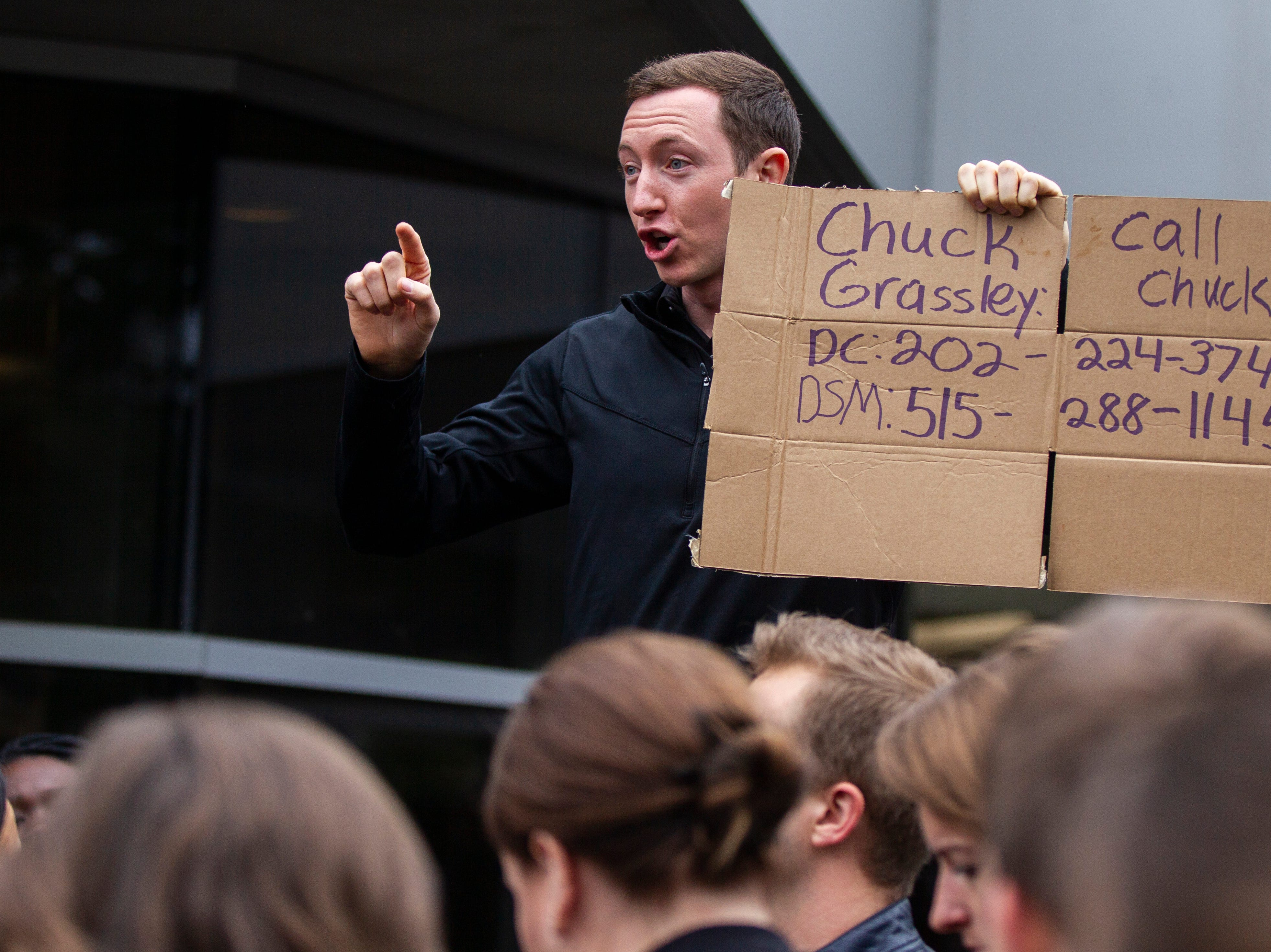 Paul Esker, a first year law student, originally from Cedar Rapids speaks during protest against Supreme Court nominee Brett Kavanaugh on Friday, Sept. 28, 2018, outside the Boyd Law Building on the University of Iowa campus in Iowa City.