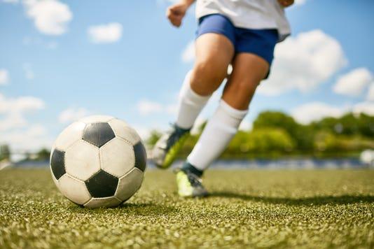 Boy Kicking Ball