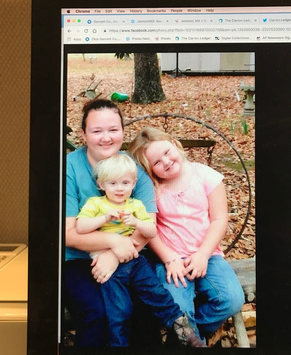 This photo of a social media post shows Leanne Hawkins Hodo and her children.