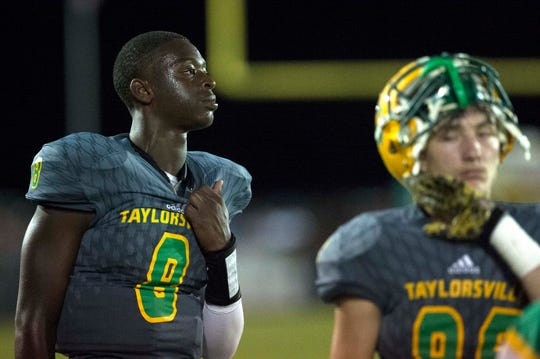 Taylorsville quarterback Ty Keyes (8) looks out at the field where his teammates play against rivals Bay Springs. Taylorsville returned from a rough first half to beat Bay Springs, 35-14, with Keyes completing 22 of 36, a total of 481 yards-a  career high.   Thursday, Sept. 27, 2018.