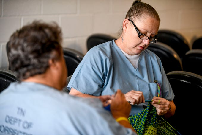 "Rhonda Norres crochets a backpack with friends she's made while working in the chapel at West Tennessee State Penitentiary in Henning, Tenn., on Wednesday, Sept. 26, 2018. ""We made a choice and ended up here,"" Norres said. ""Those ladies coming out of sex trafficking had no choice, we may as well do some good and try to help out while we're in here."""