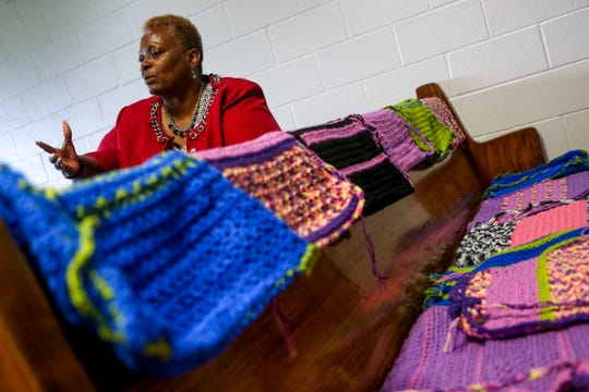 Chaplain Alma Harris, the director of the program for residents crocheting, is seen here sitting at a pew with many of the backpacks crocheted by residents at West Tennessee State Penitentiary in Henning, Tenn., on Wednesday, Sept. 26, 2018.