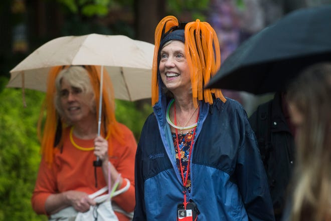 Jenny Peek of Knoxville, at center, walks around Dollywood's second Great Pumpkin LumiNights festival in Pigeon Forge on Sept. 27. The festival has doubled in size since last year.