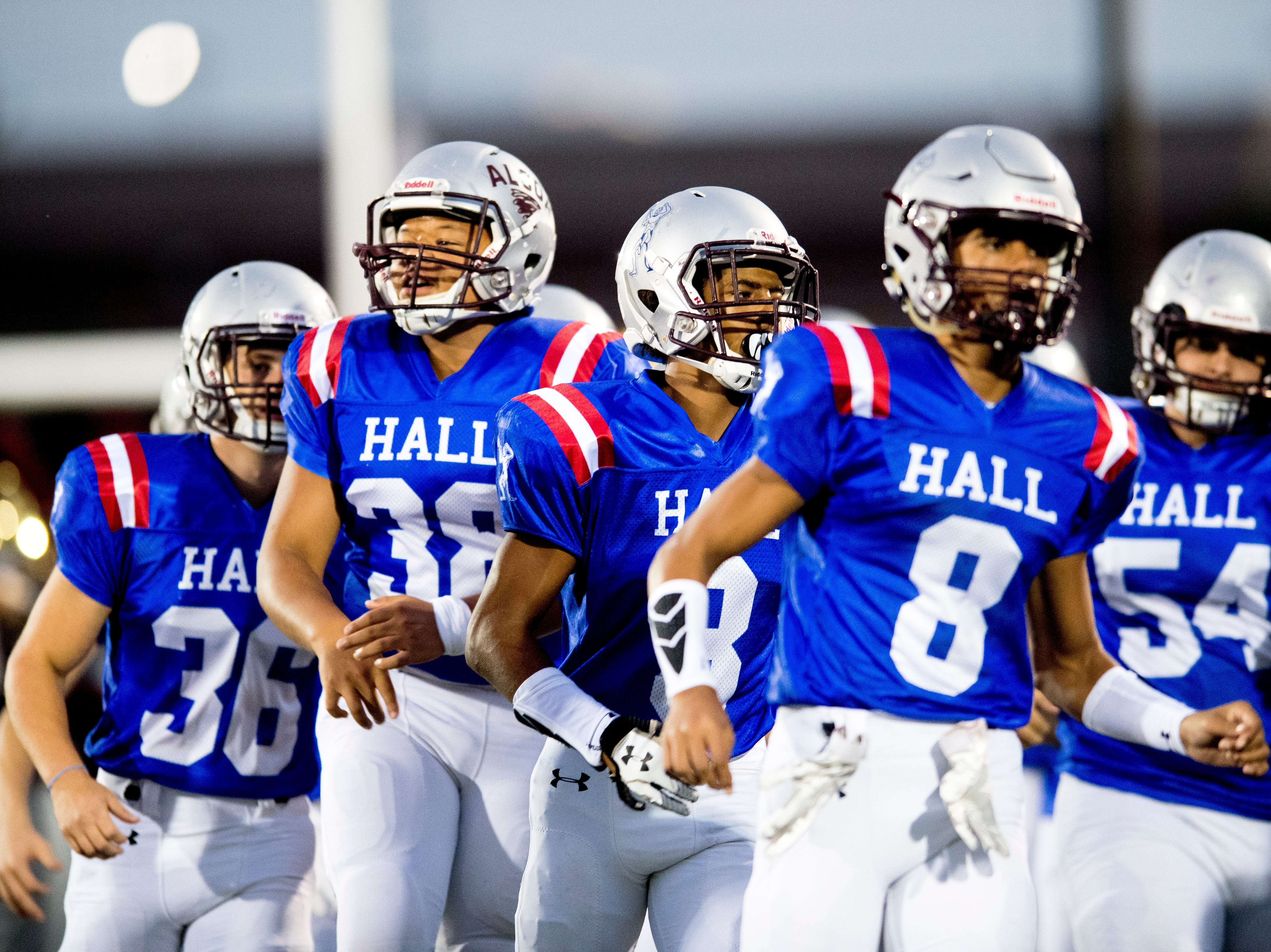 Alcoa in Hall High School jerseys storm the field during a game between Alcoa and Northview at Alcoa High School in Alcoa, Tennessee on Friday, September 28, 2018.