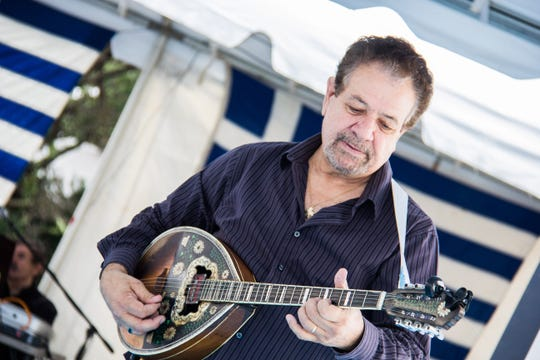 Themi Kakias plays the bouzouki during the first day of Greek Fest on Sept. 28, 2018.