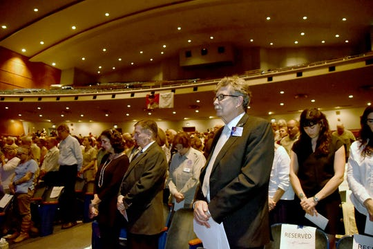 A moment of remembrance and silence at a public memorial for Stan Brock, founder of Remote Area Medical, at the Knoxville Civic Auditorium on Thursday, Sept. 27, 2018. Brock, who died Aug. 29, was an advocate for providing health care to those in need around the world. (J. Miles Cary/Special to the News Sentinel)