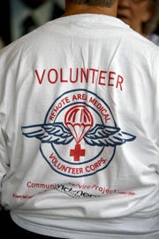 A Volunteer wears a Remote Area Medical shirt at a public memorial for Stan Brock, founder of Remote Area Medical, at the Knoxville Civic Auditorium on Thursday, Sept. 27, 2018. Brock, who died Aug. 29, was an advocate for providing health care to those in need around the world. (J. Miles Cary/Special to the News Sentinel)