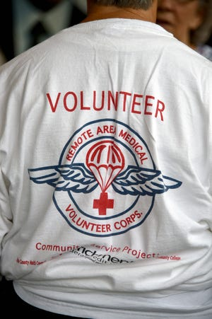 A Volunteer wears a Remote Area Medical shirt at a public memorial for Stan Brock, founder of Remote Area Medical, at the Knoxville Civic Auditorium on Thursday, Sept. 27, 2018. Brock, who died Aug. 29, was an advocate for providing health care to those in need around the world. 