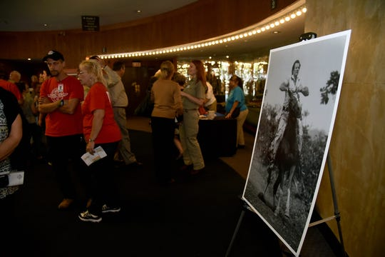 Volunteers and friends in the lobby of the Knoxville Civic Auditorium at a public memorial for Stan Brock, founder of Remote Area Medical, on Thursday, Sept. 27, 2018. Brock, who died Aug. 29, was an advocate for providing health care to those in need around the world. (J. Miles Cary/Special to the News Sentinel)