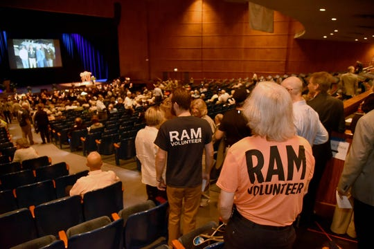 Volunteers and friends of Remote Area Medical fill the seats         at a public memorial for Stan Brock, founder of Remote Area Medical, at the Knoxville Civic Auditorium on Thursday, Sept. 27, 2018. Brock, who died Aug. 29, was an advocate for providing health care to those in need around the world. (J. Miles Cary/Special to the News Sentinel)