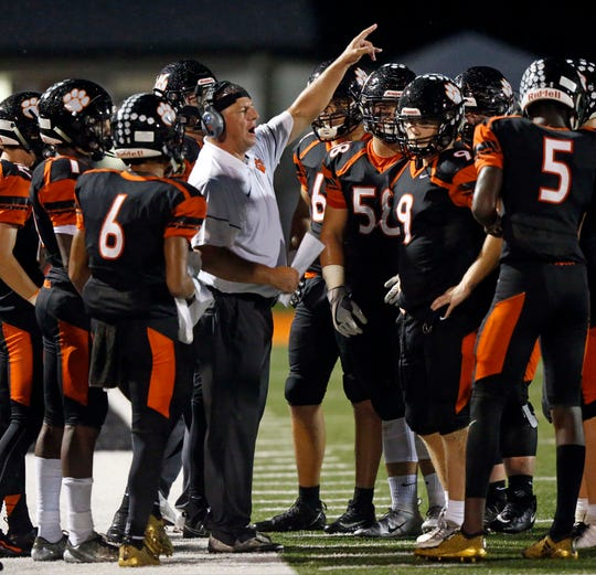 Powell head coach Matt Lowe directs his team during their game against Campbell County Thursday, Sept. 27, 2018, in Knoxville, Tenn.
