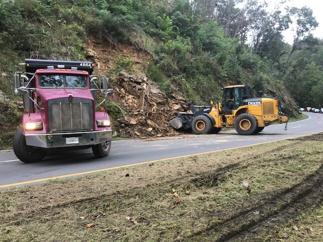 Crews are removed debris from a rockslide along Route 441 Southbound Spur between Gatlinburg and Pigeon Forge Friday, Sept. 28, 2018.