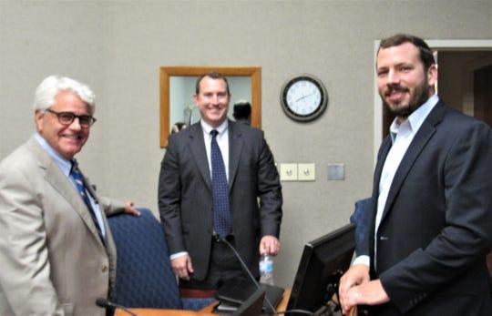 Town Attorney Tom Hale and Town Administrator David Smoak congratulate new Alderman Drew Burnette.