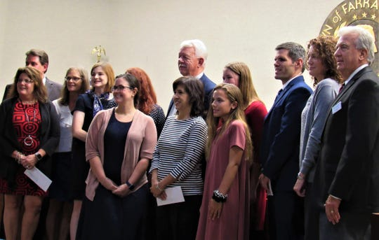 Students, school representatives and officials lined up with Mayor Ron Williams, center, as he presented donations to all four Farragut schools and the FHS Education Foundation.