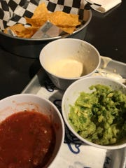 Our triple dipper, almost entirely devoured, at one time was totally filled with chips, queso, guacamole and salsa.