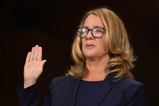 Christine Blasey Ford is sworn in to testify before the Senate Judiciary Committee on Capitol Hill in Washington on Sept. 27, 2018.