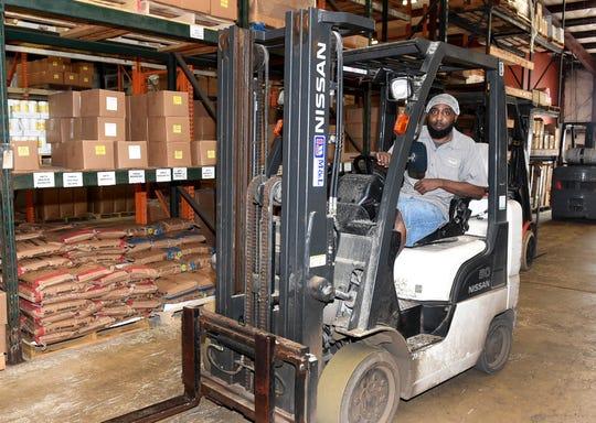 Jeremy Tyler works the forklift in the warehouse at Targil Seasoning in Opelousas.