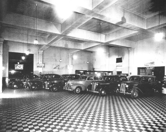 Shown is the interior of White Motor Sales about the time it opened in 1935. This original tile floor can still be seen today at 235 S. Columbus St., home of North End Press. Photo submitted by River Valley Collision.