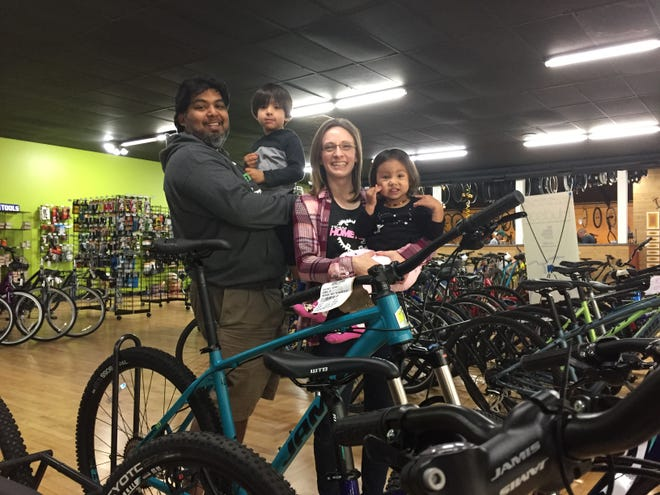 Hometown Bicycles owners Shaun and Dawn Bhajan, seen Friday, Sept. 28, 2018 with their son Liam, 3, and Aria, 2, are gearing up to double the size of their shop by revamping a back storage area.