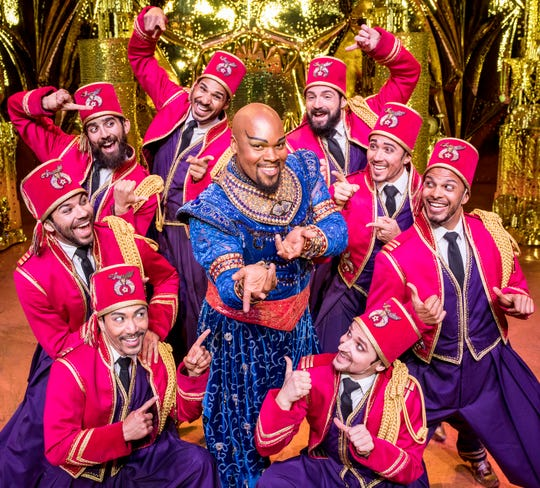 "Michael James Scott, center, has all of the fun in ""Disney's Aladdin"" playing the genie."