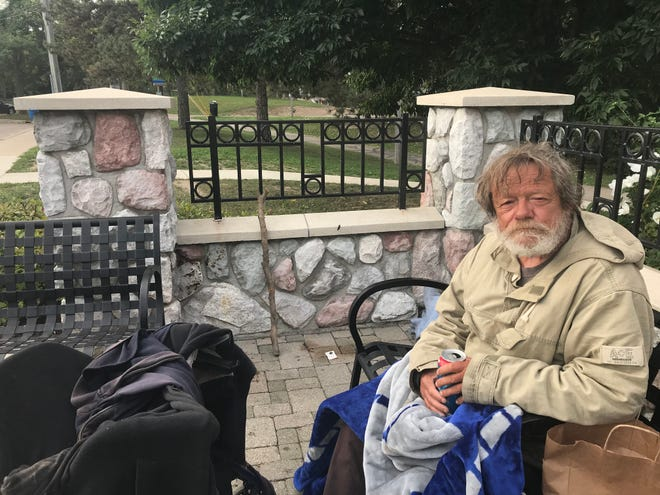 Richard Stanton, a homeless man, sits on a bench Sept. 19, 2018 by a spot where he spent the night in Lansing's Old Town. Some in Old Town are trying to help him.