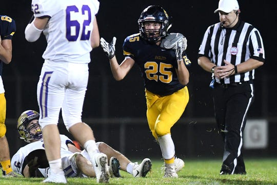 Haslett's Chance Cook celebrated Sept. 14 after recording a sack during the third quarter of the team's game against Fowlerville. An official looked on and is expected to be one of at least 9,000 registered with the Michigan High School Athletic Association.