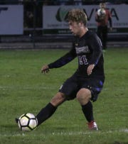 Ontario's Brennan Blaising kicks the ball down the field while playing against Madison on Thursday evening.