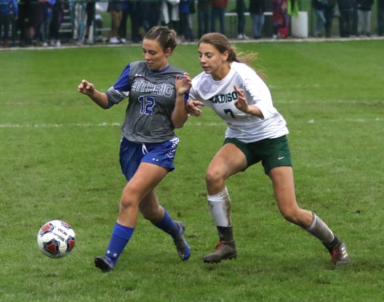 Ontario's Keirstyn Carpenter and Madison's Kari Eckenwiler go for the ball on Thursday evening.