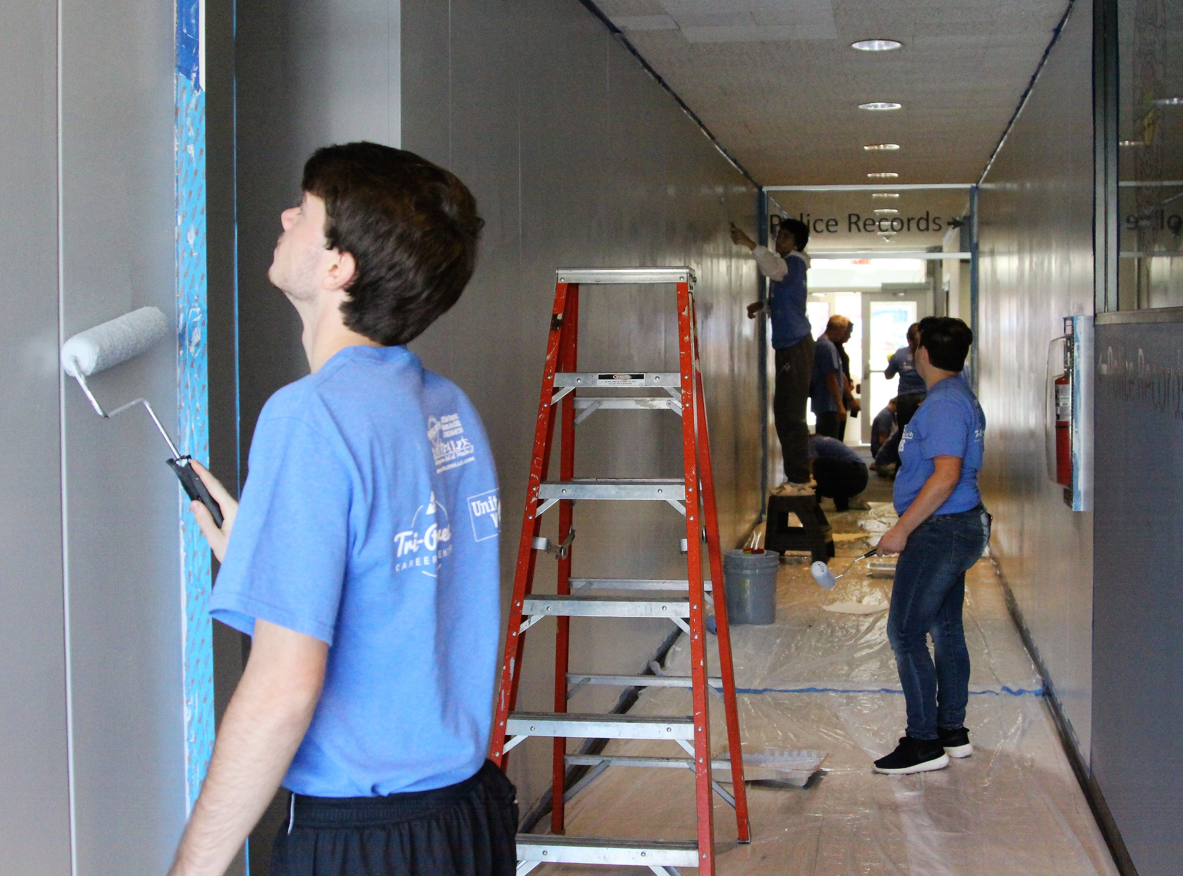 Criminal justice students at Tri-Rivers paint the hallway outside of the Marion Police Department on Friday as part of the career center's Make A Difference Day. Seniors were sent all over the county, each being assigned a community service project to complete.