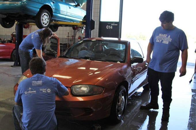 A group of students at Tri-Rivers Career Center spent most of their Friday vacuuming, washing and waxing cars that came from the Marion County Sheriff's office as well as the Turning Point shelter. It was part of the school's annual Make A Difference Day, that saw students volunteering across the county.