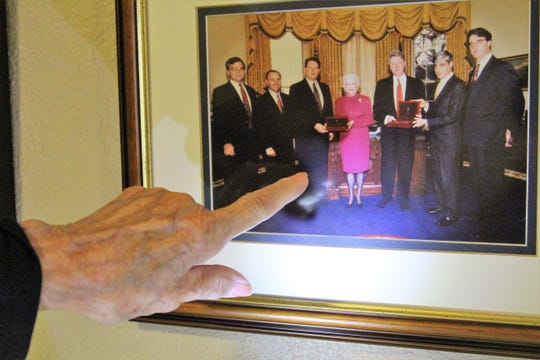Mary Ellen Withrow points to a picture from her time in office as U.S. Treasurer under Bill Clinton. The picture along with relics from her long political career hang in her museum on Thursday.