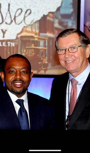 Shelby County Schools board member Kevin Woods, left, was likely one of the last people to see Greater Memphis Chamber CEO Phil Trenary, right, alive before Trenary was shot and killed in Downtown Thursday night. The two had long worked together on workforce issues.