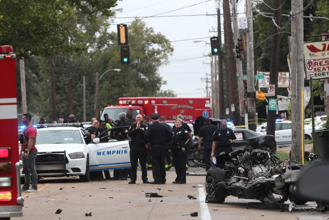 Memphis first responders work the scene where a police chase lead to a series of accidents near the intersection of Mississippi Blvd and East McLemore Avenue on Friday, Sept. 28, 2018.
