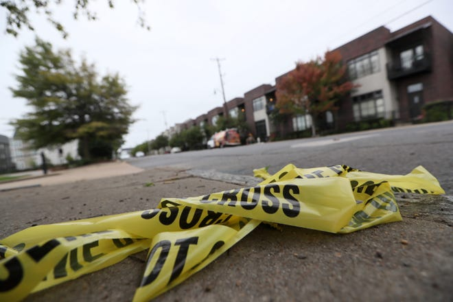 Police tape was left along the sidewalk of South Front Street where Phil Trenary, head of the Greater Memphis Chamber, was killed in a shooting.