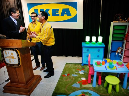 The late Memphis Chamber of Commerce President and CEO Phil Trenary (left) jokes with Ikea's Real Estate Manager Reed Lyons and Expansion Public Affairs Manager Joseph Roth (right) after a press conference in City Hall in December 2014 to announce a new Ikea store in the Wolfchase area.