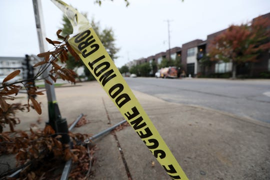 Leftover police tape lays along the sidewalk of South Front Street where Phil Trenary, head of the Greater Memphis Chamber, was killed in a shooting on Thursday night.