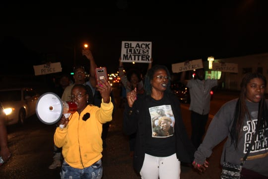Janice Banks, mother of Martavious Banks, marches next to Barbara Buress during a protest for the police-involved shooting of Martavious Banks.