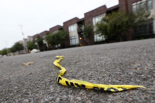 Leftover police tape lays along South Front Street in 2018 where Phil Trenary, head of the Greater Memphis Chamber, was killed.