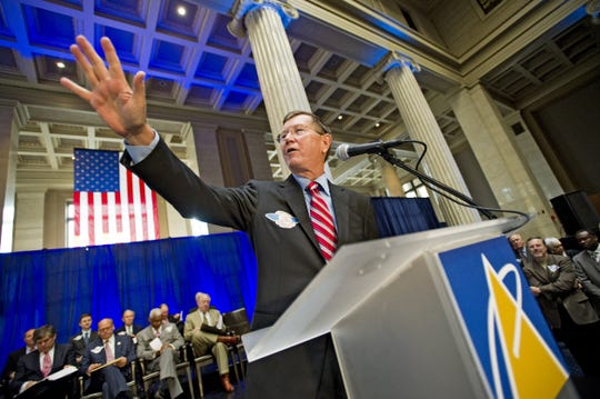 Pinnacle Airlines President Phil Trenary addresses hundreds of employees, downtown supporters and officials during a celebration commemorating his company's move to its new headquarters at One Commerce Square on Oct. 8, 2010.