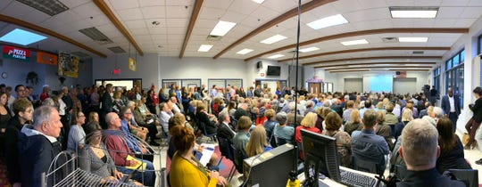People fill the Bayside Middle School cafeteria in Bayside on Sept. 27 during a public meeting on the proposed 30-story $200 million mixed-use apartment tower in Bayside.