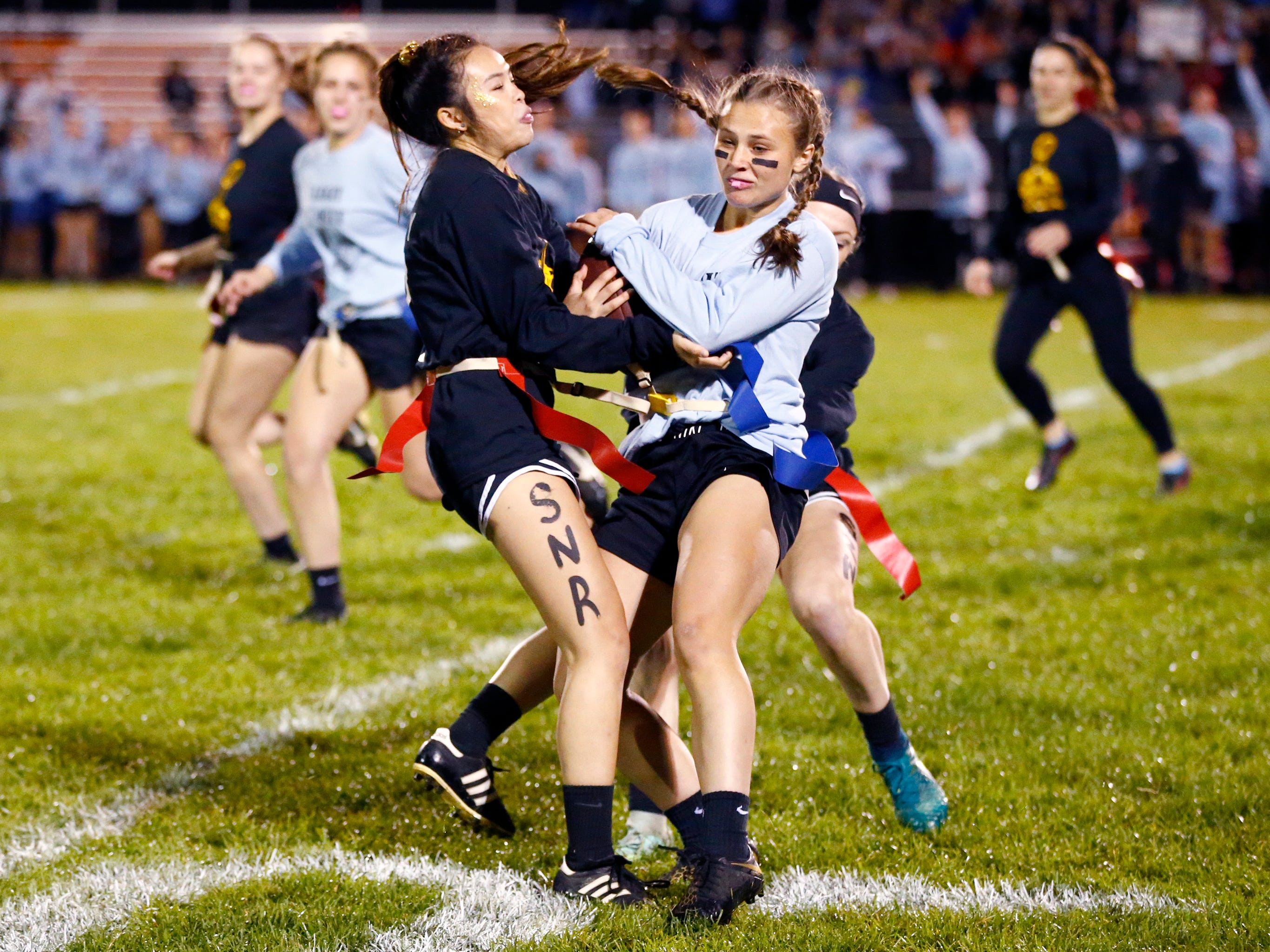Senior girls in black took on the Junior Girls in a Homecoming Powder Puff football game at Grafton High School on Sept. 27.