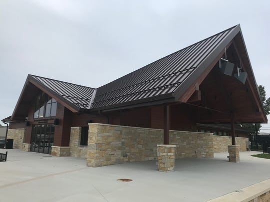 This building at Richard E. Maslowski Community Park features a covered outdoor stage, a concession stand, locker rooms, restrooms, storage areas and the David Hobbs Honda for the People Community Room.