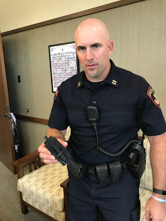 Middleton Police Capt. Troy Hellenbrand holds a combat tourniquet he always carries with him. Middleton police were issued tourniquets several years ago to help stop bleeding.