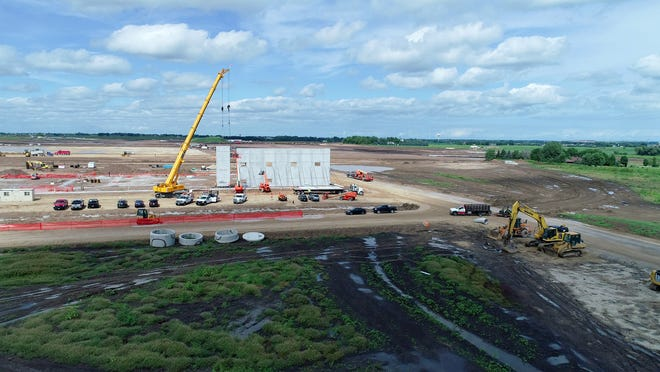 A crane erects a wall for the first building on the Foxconn site in this August 29 photo.