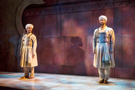 "Owa'Aìs Azeem (left) eyes Yousof Sultani in ""Guards at the Taj,"" performed by Milwaukee Repertory Theater."