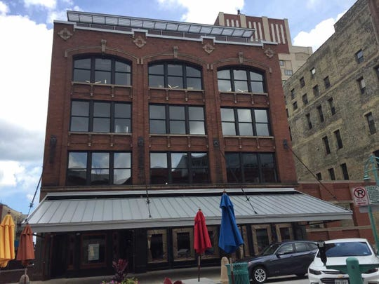The redeveloped former Jennaro Bros. produce warehouse includes a restored awning that will serve a future restaurant tenant's sidewalk dining space.