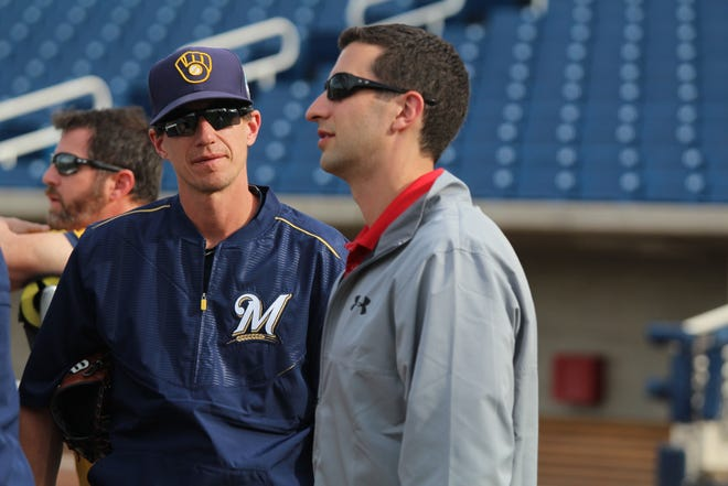 The multitude of moves made by general manager David Stearns (right) and the guidance of manager Craig Counsell have led the Brewers to the playoffs after beginning a massive rebuild in 2015.